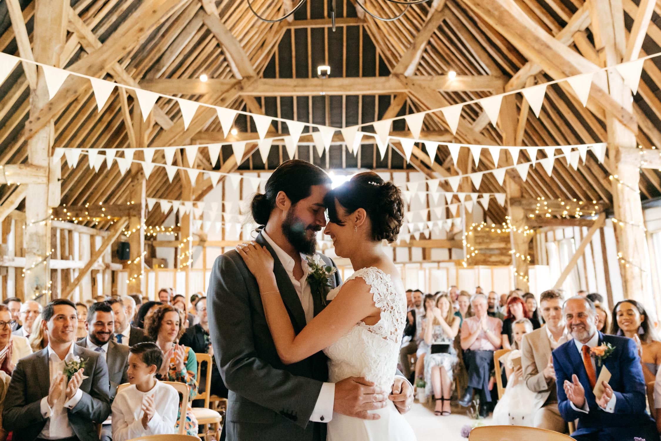 candid wedding photo of wedding ceremony at clock barn