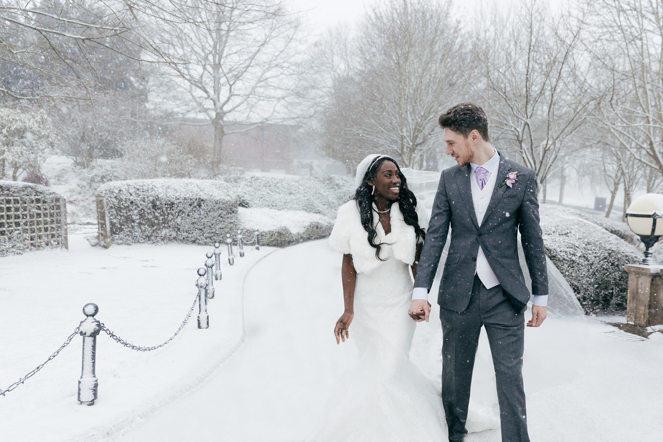 mixed race couple in snow on wedding day