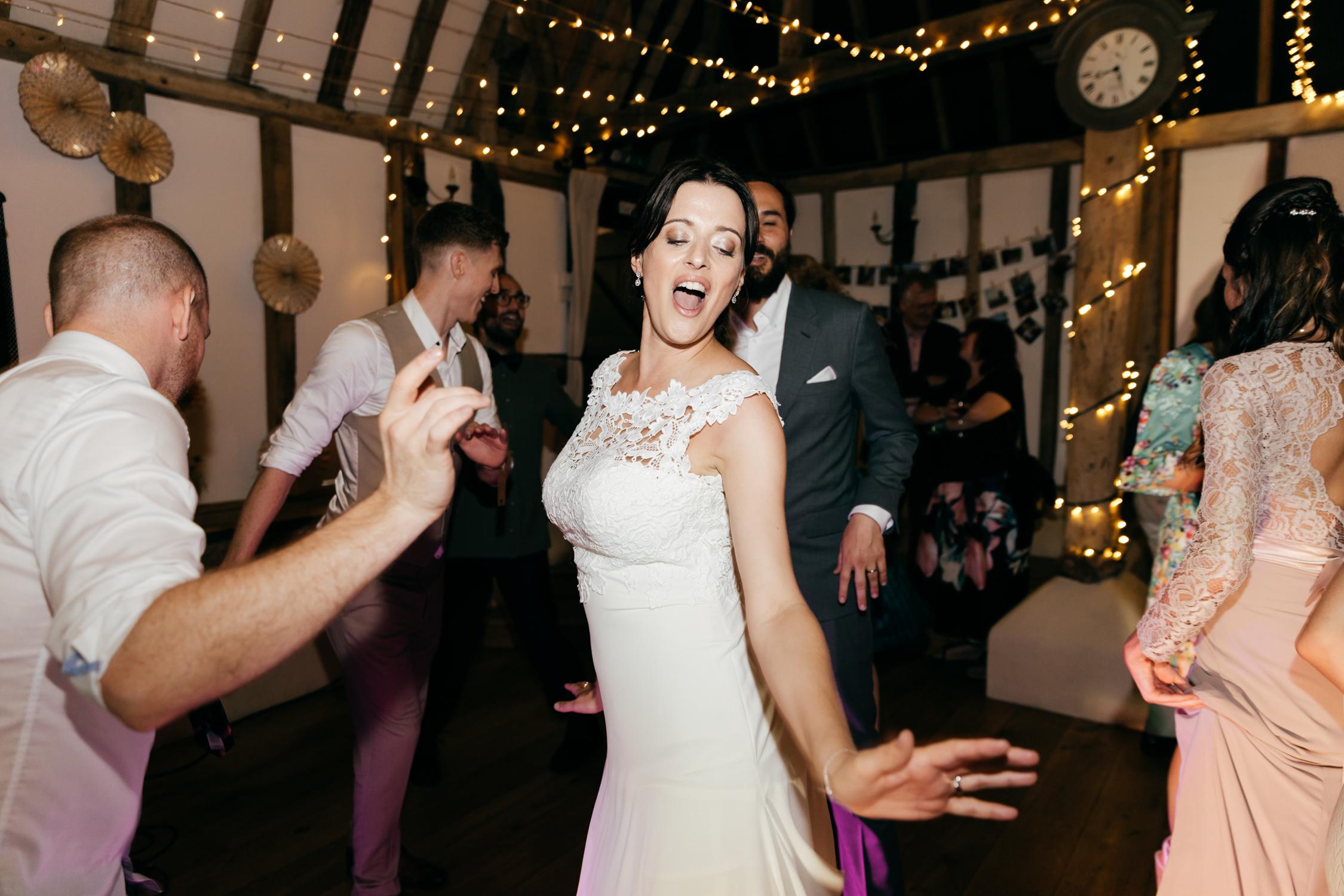 bride on dancefloor at the clock barn wedding