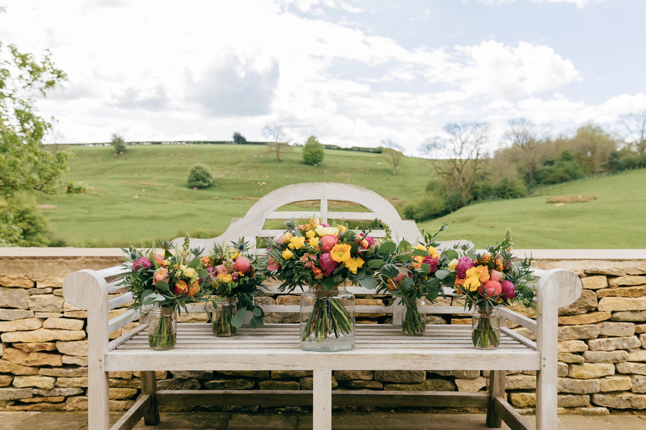 bright bridal bouquets for a kingscote barn summer wedding