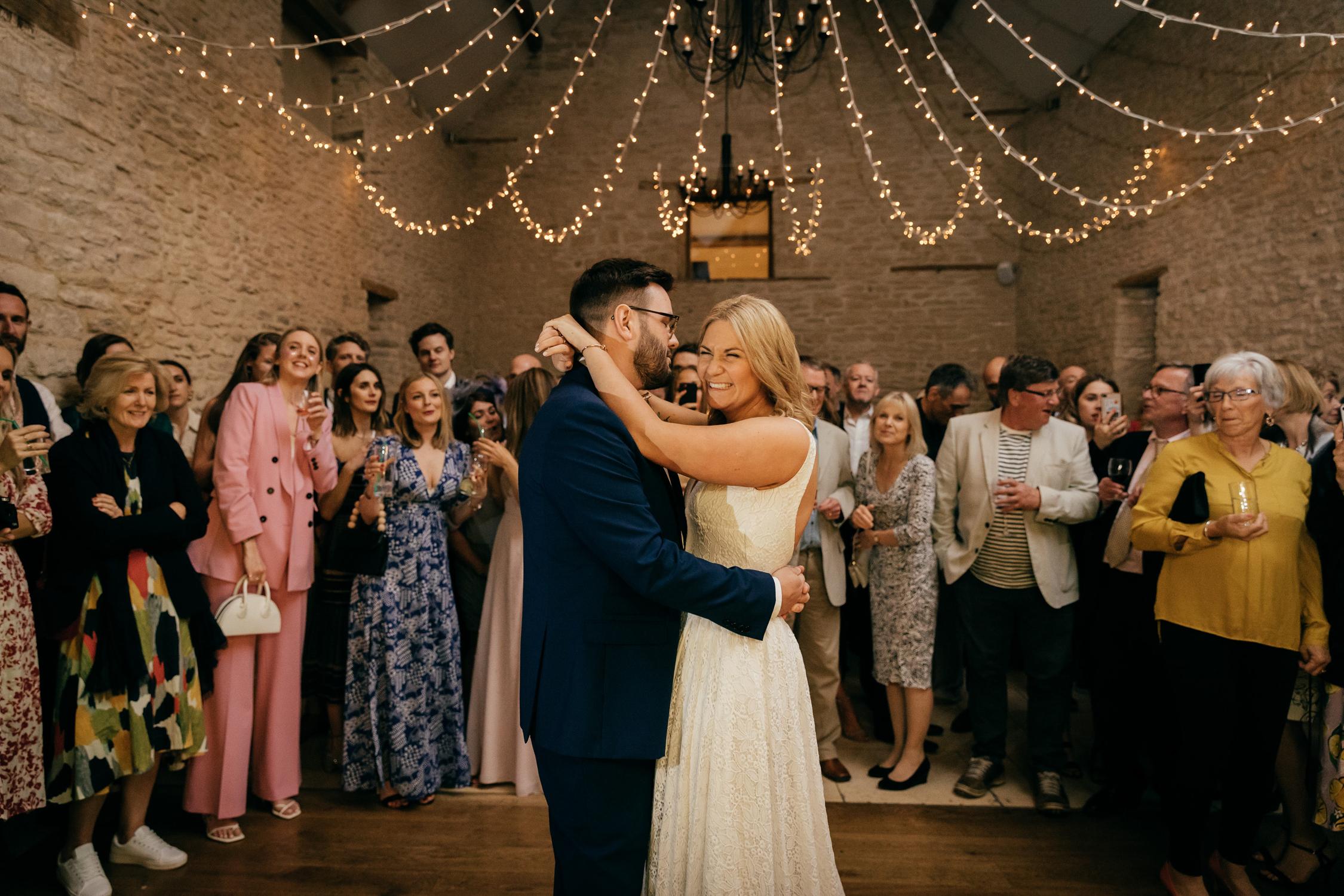 documentary wedding photo of the first dance at kingscote barn wedding