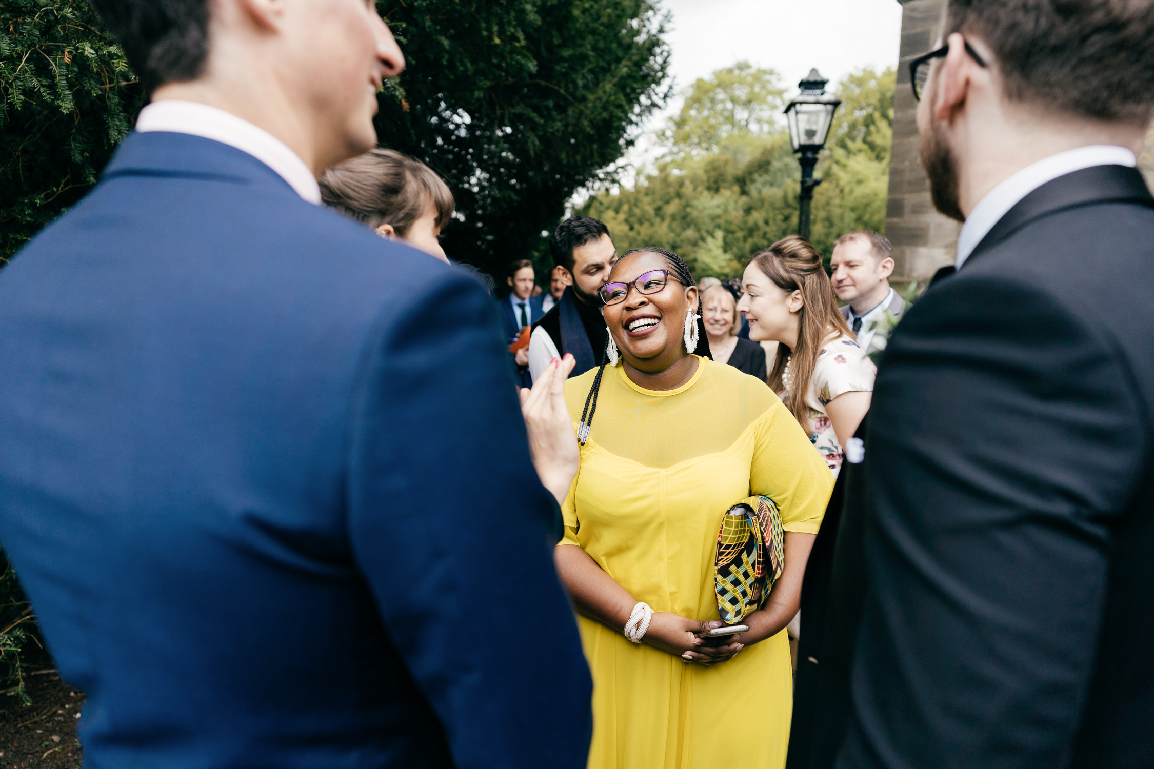 candid wedding photo of a happy guest at wedding reception