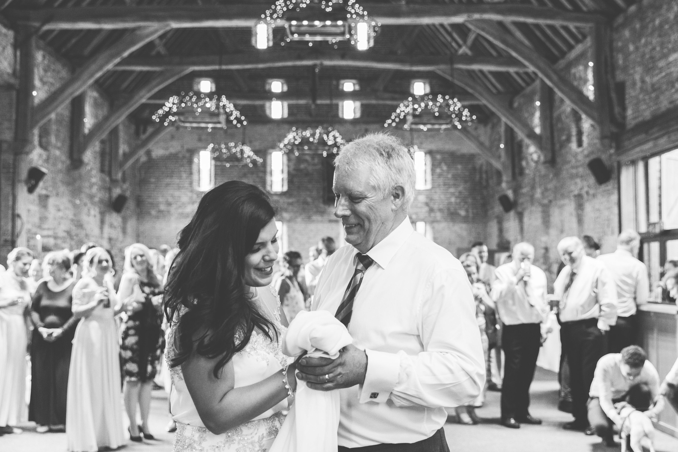 documentary photo of bride and father dance