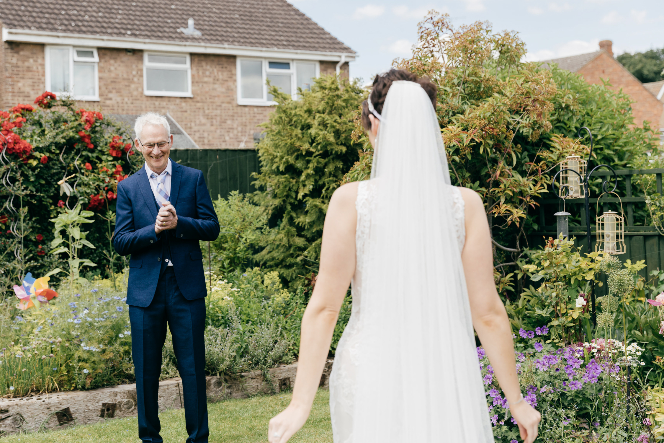 natural wedding photo of an emotional father seeing bride in her dress on wedding day