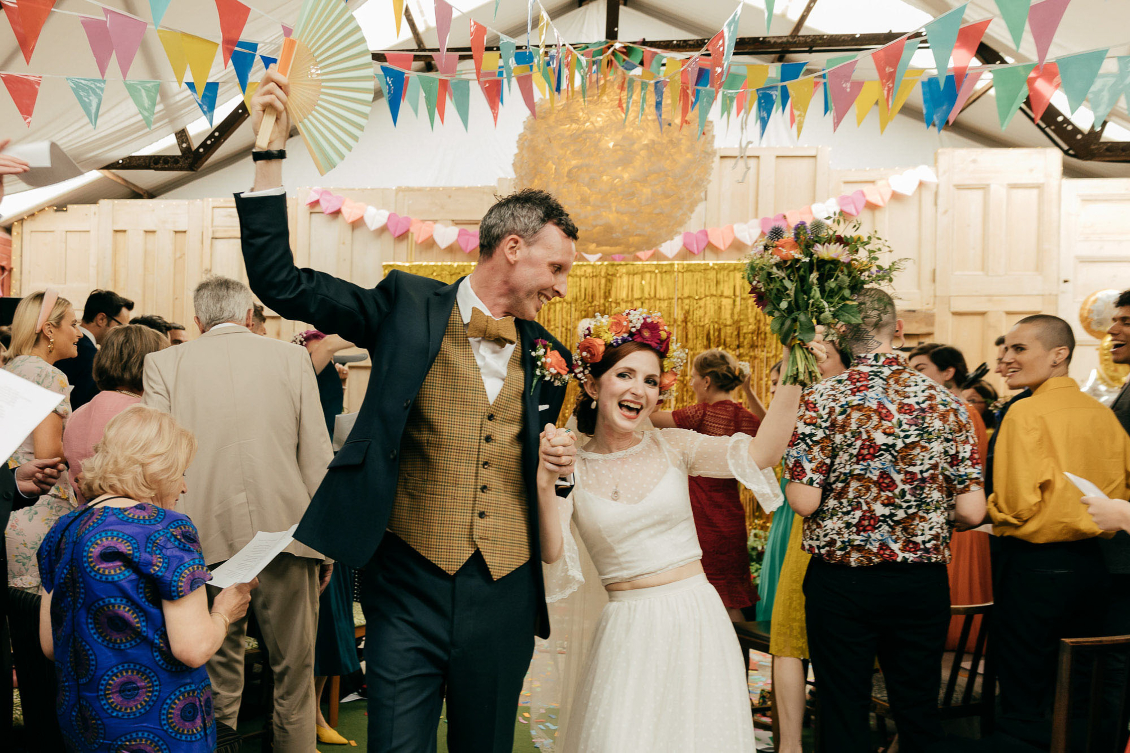 bride and groom with quirky vintage bridal style celebrate their marriage