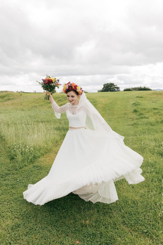 bride twirls in vintage inspired bridal two piece