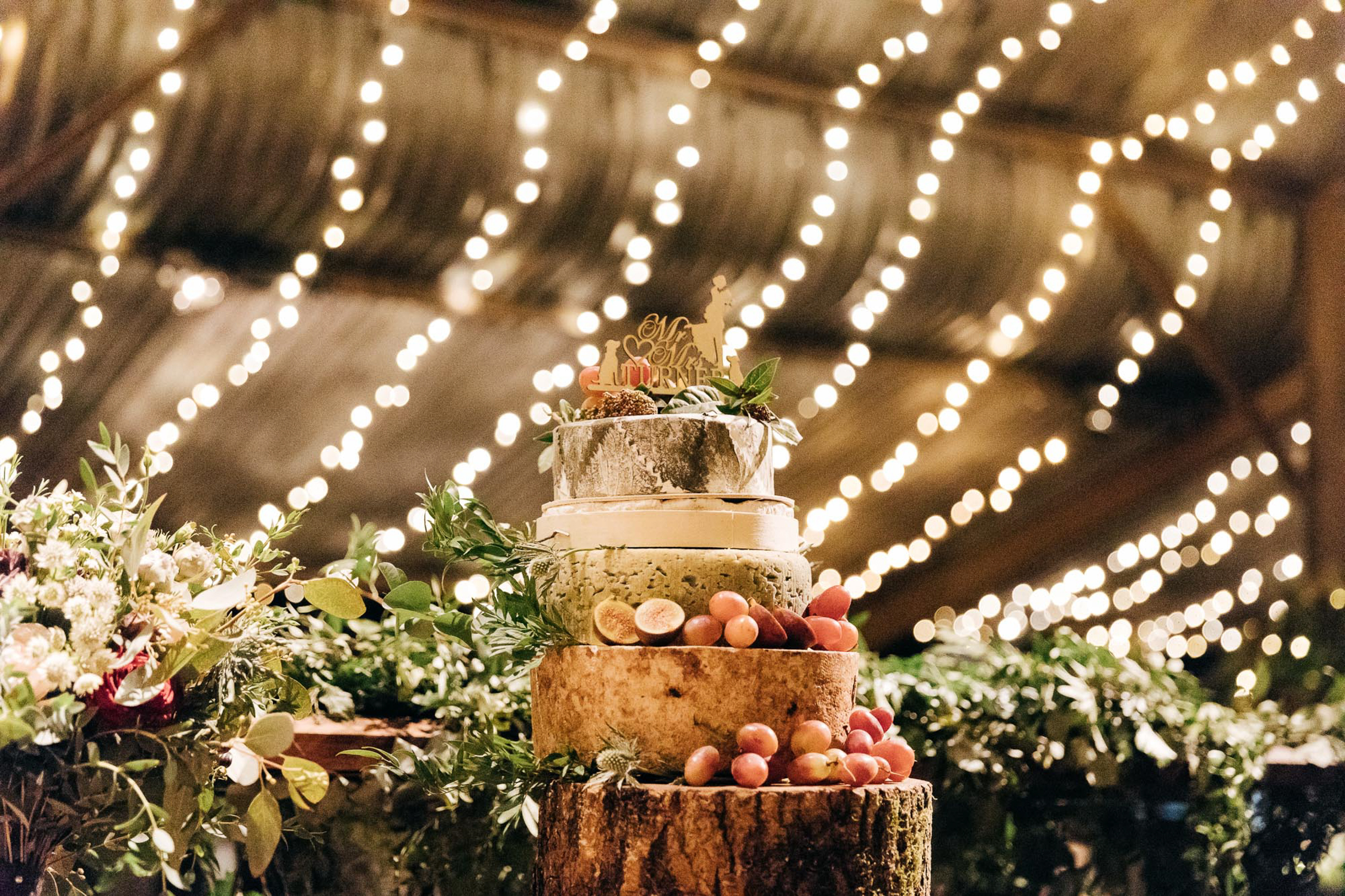 stylish photography of wedding cheese cake at the stone barn cotswolds