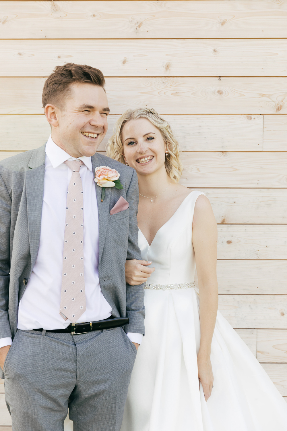 relaxed portrait of bride and groom at cotswold village hall wedding