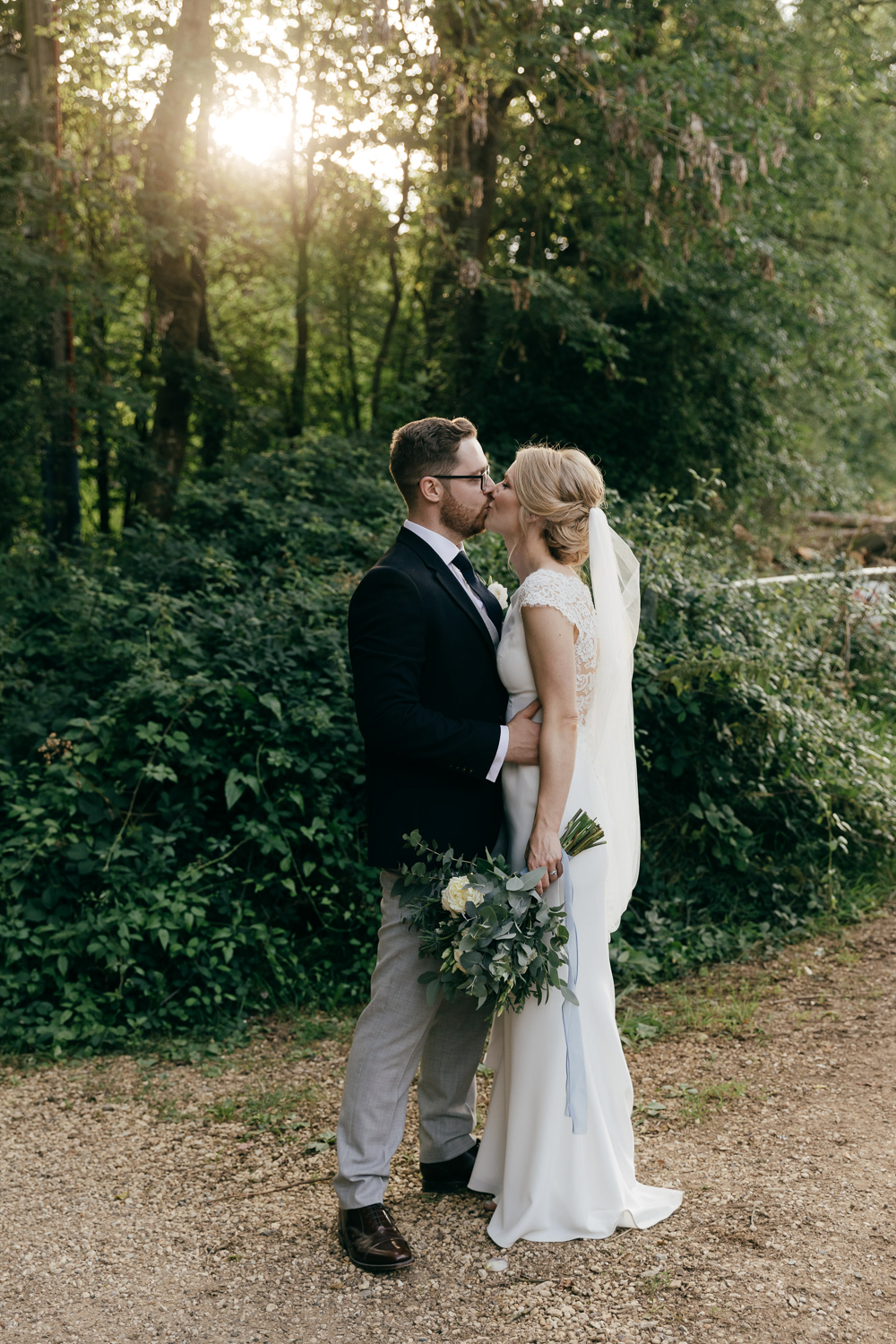 golden hour portraits of bride and groom at cripps barn in the cotswolds
