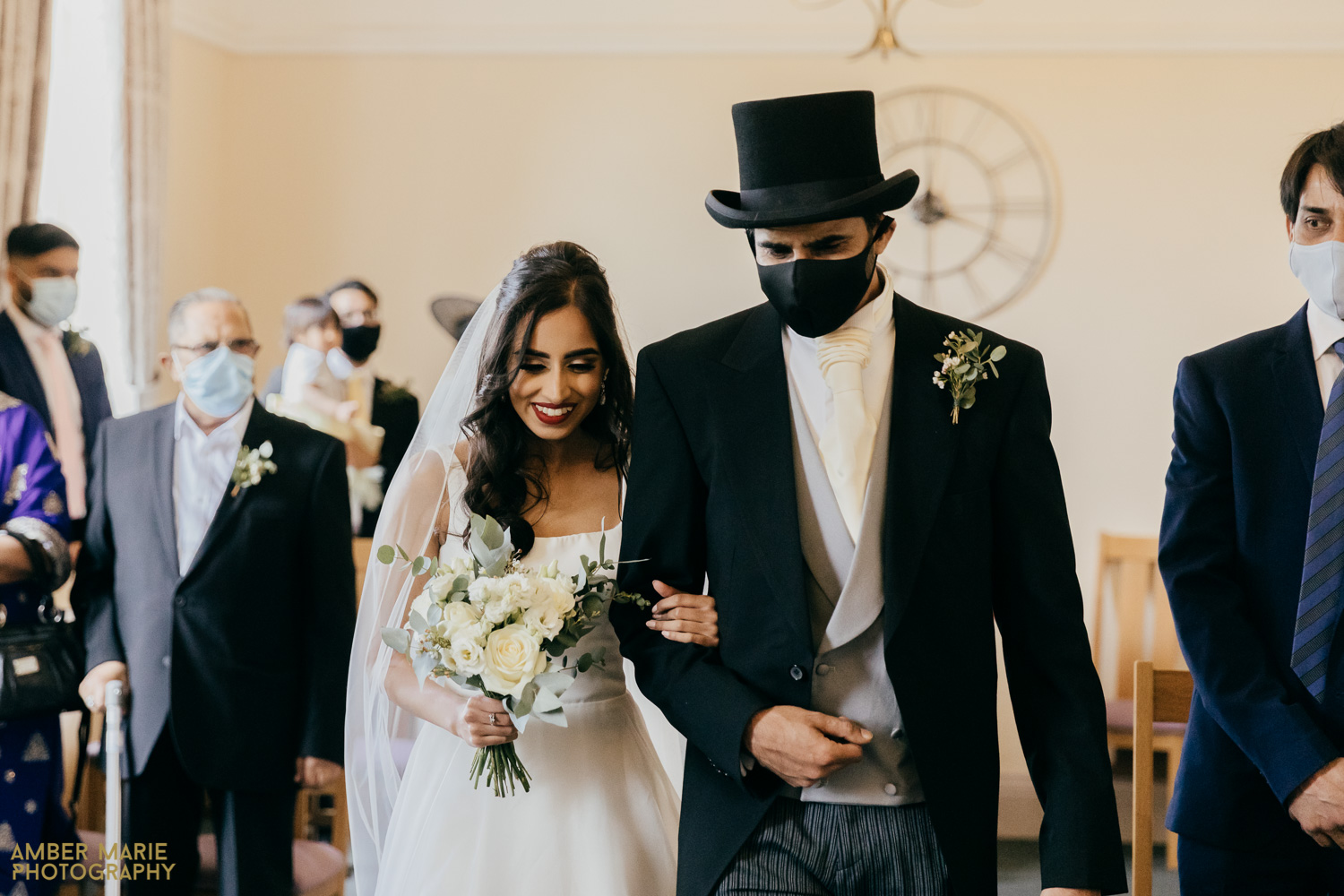 Candid photo of bride and dad walking down aisle