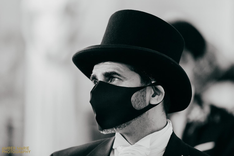 Natural photo of bride's dad at wedding wearing face mask at wedding