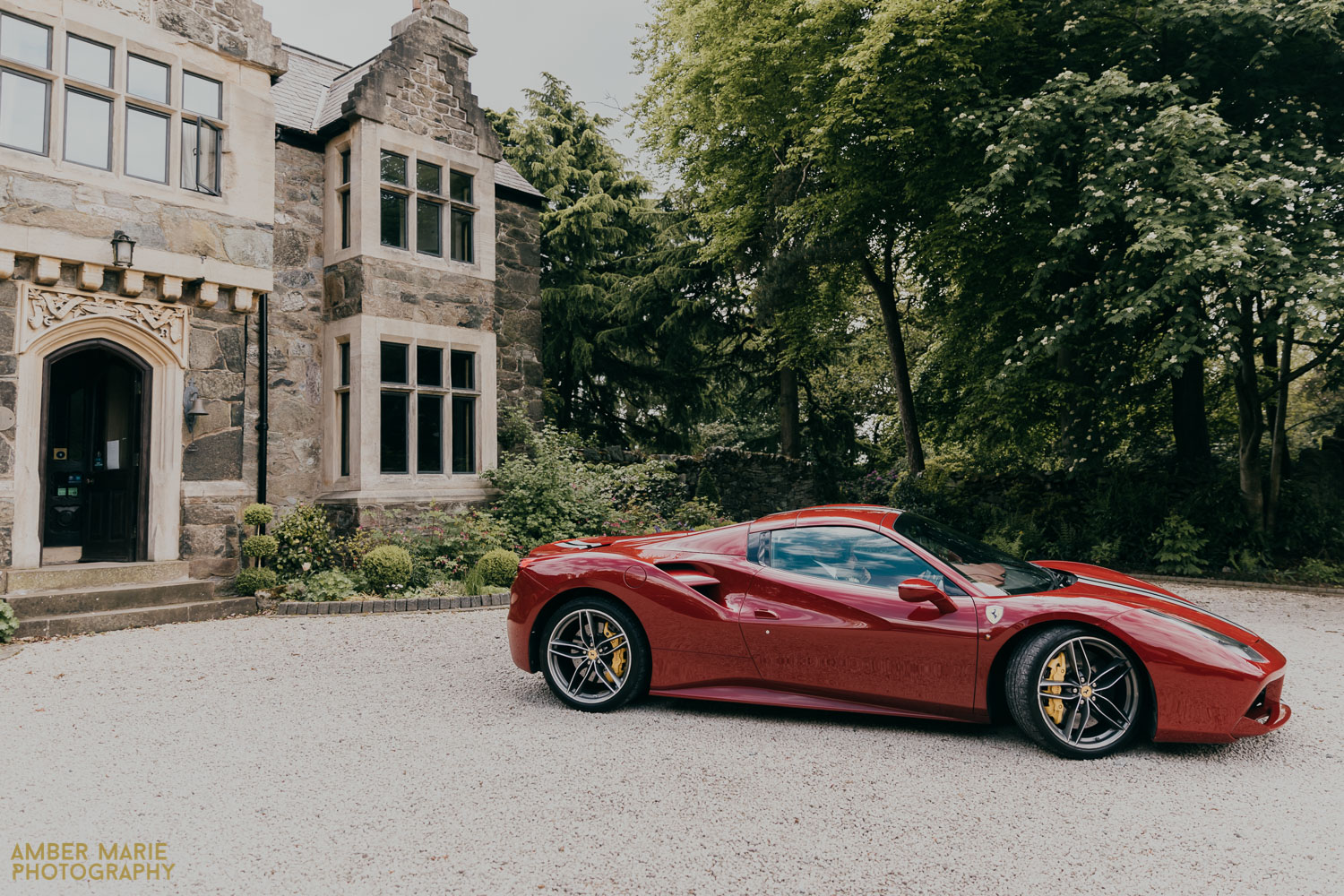 Bride and groom arriving at Abbots Oak wedding in red Ferrari
