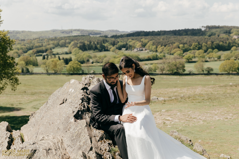 Bride sat on grooms knee in Bradgate Park
