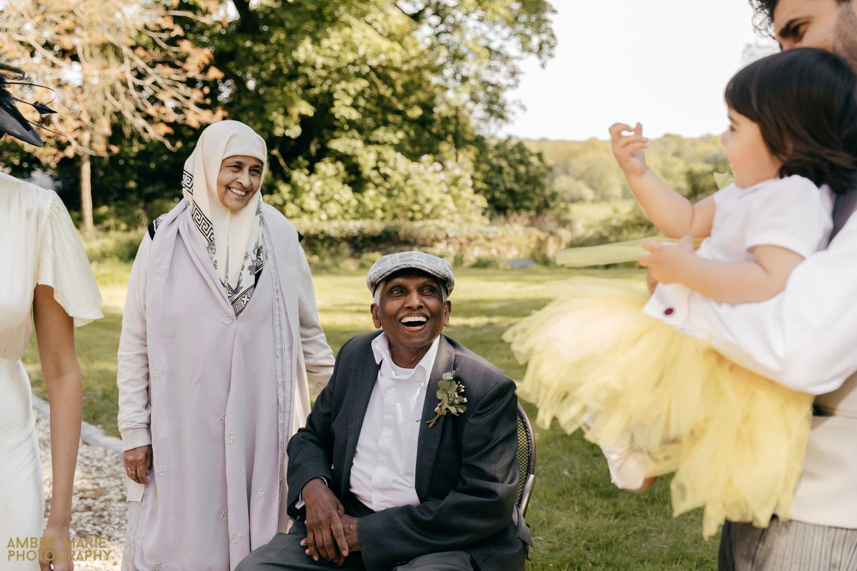 Grandparent sat down at wedding laughing