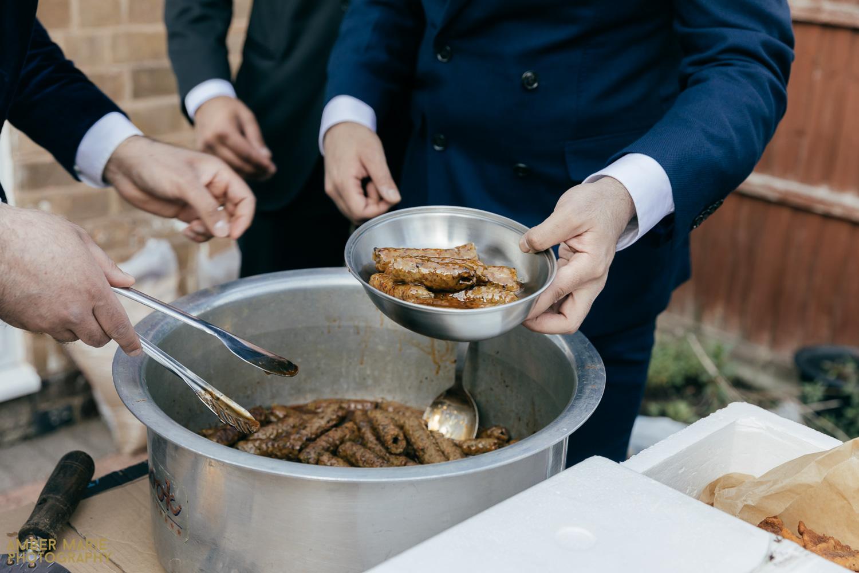 Sausages being served at garden wedding