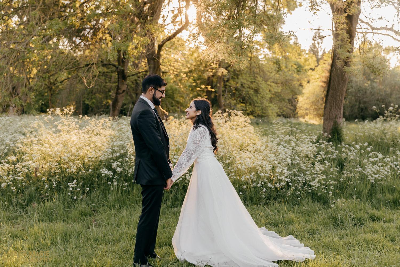 sunset wedding photo in wildflower meadow