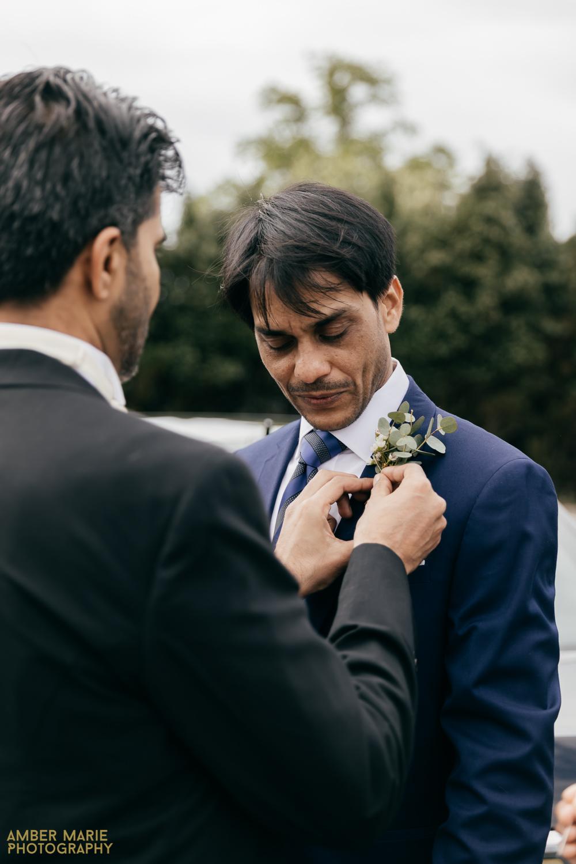 candid wedding photo by creative wedding photographer Amber Marie Photography