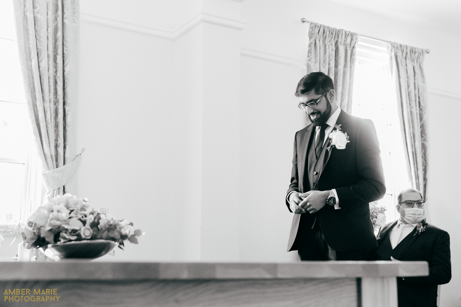Candid wedding photo of groom waiting at Coalville Registry Office Leicester