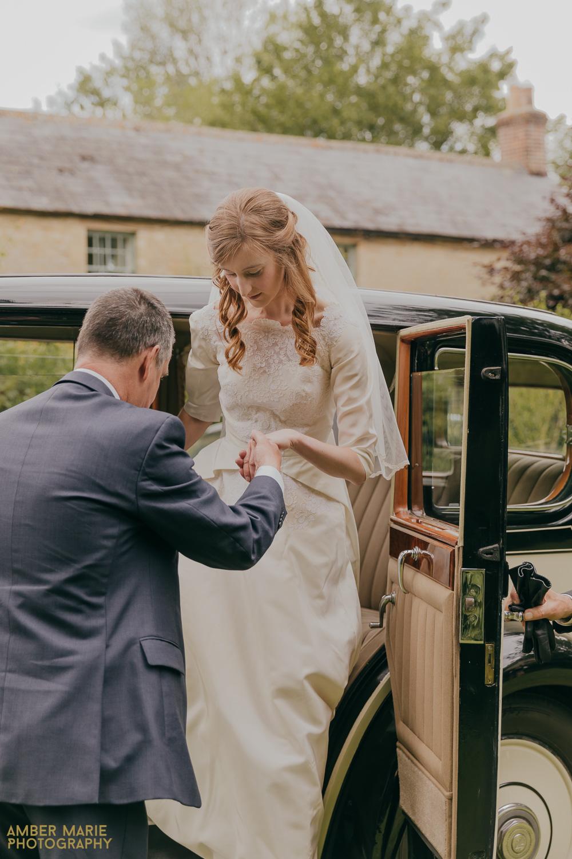 Natural wedding photo of bride wearing vintage family heirloom wedding dress