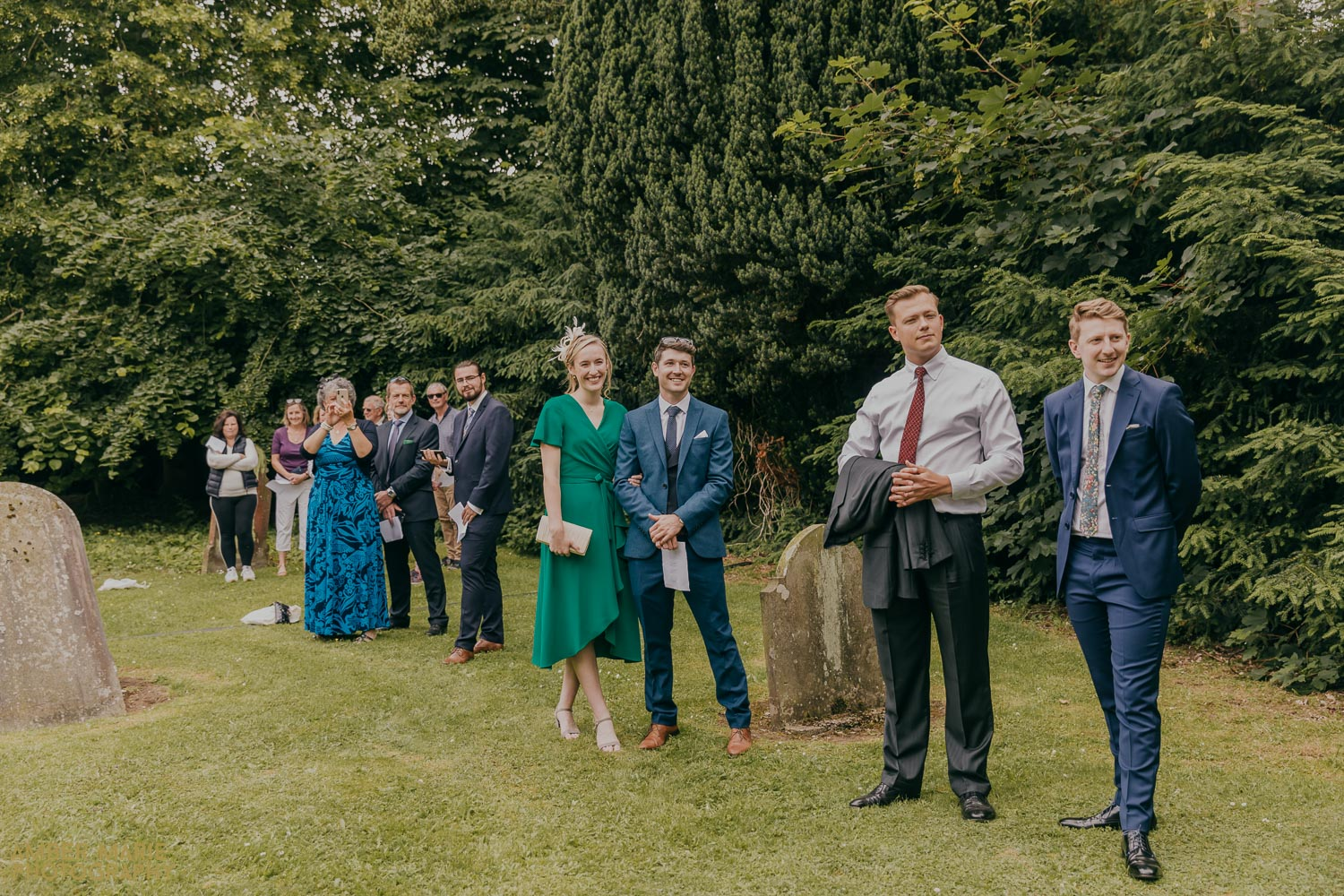 candid wedding photo of guests waiting outside church