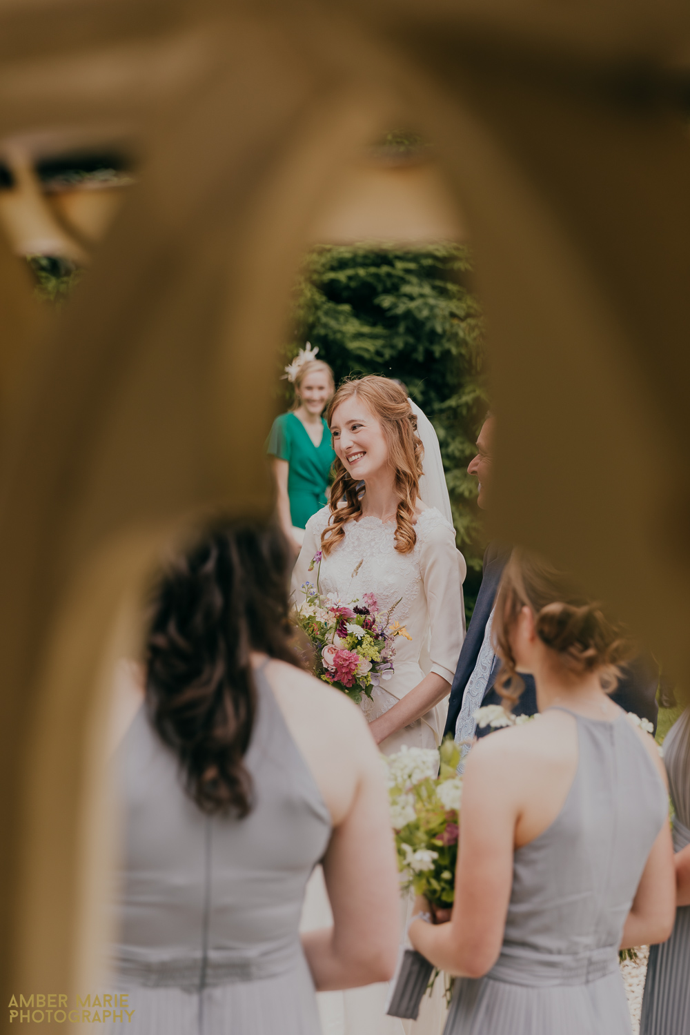 Candid wedding photography of bride chatting to guests
