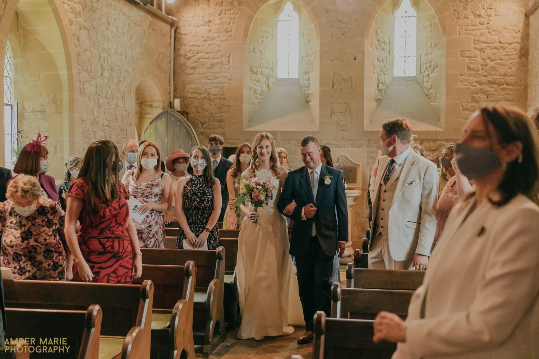 Bride walking down aisle of Whelford Church Ceremony