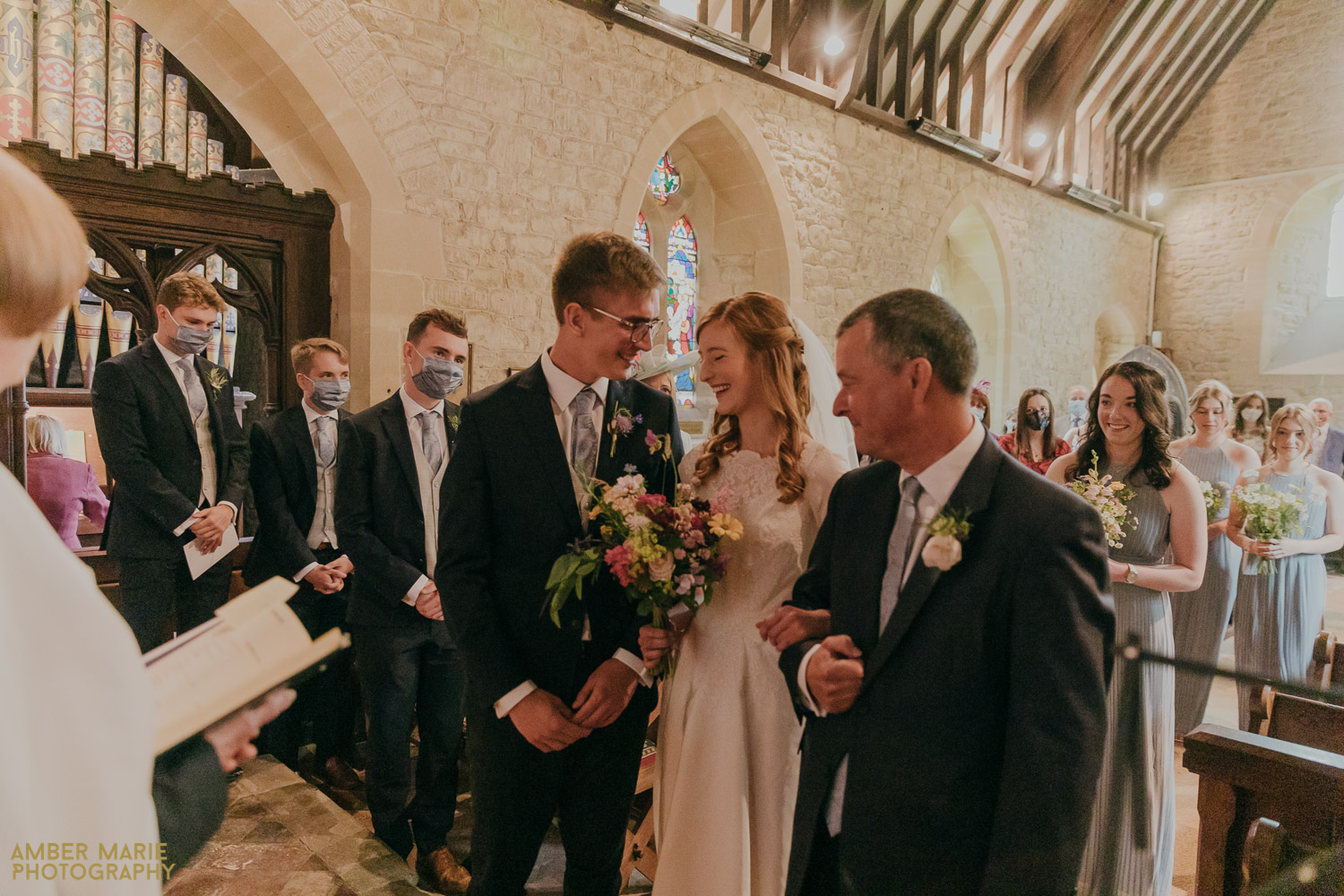 Documentary wedding photo of bride and groom during church ceremony