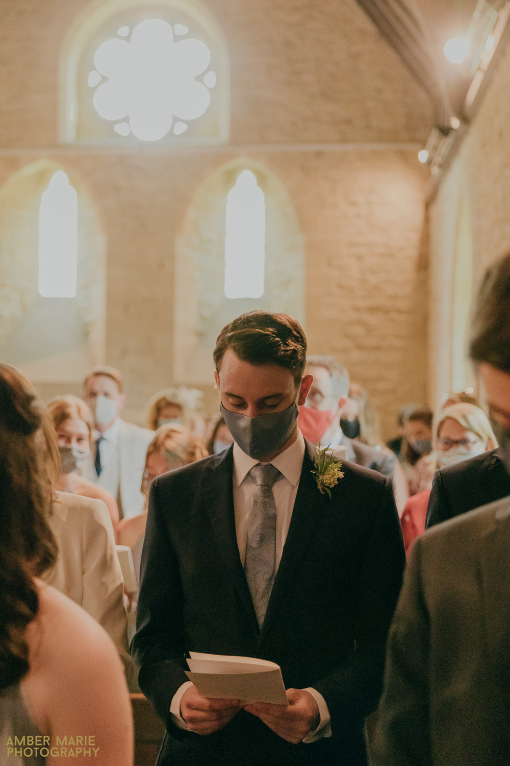 Wedding guest at Whelford Church in Fairford wearing a face mask