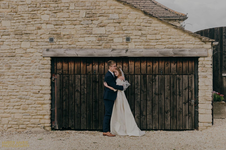 Rustic wedding photos of bride and groom embracing