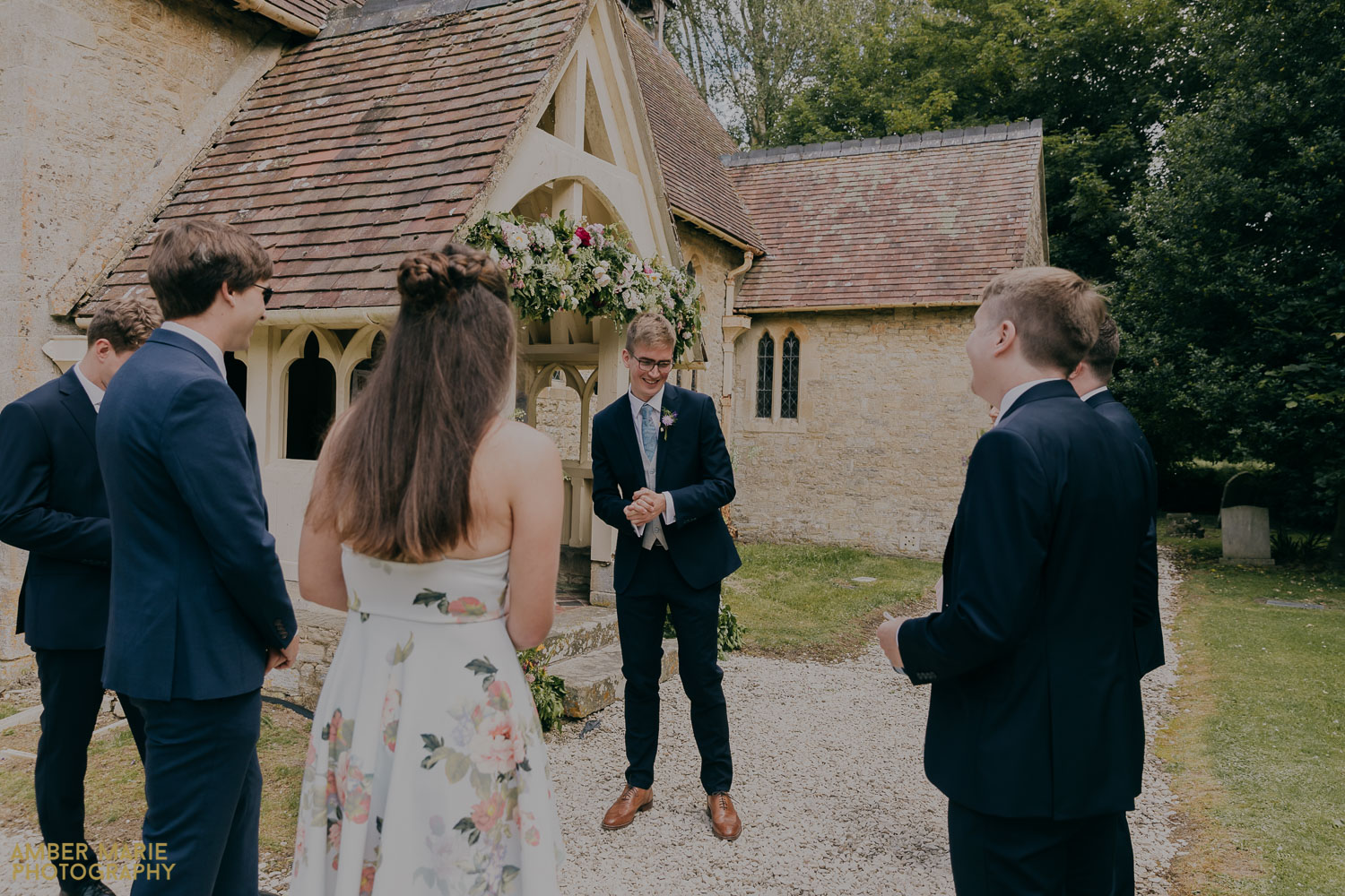 Natural wedding photography of groom at a summer church wedding in Fairford