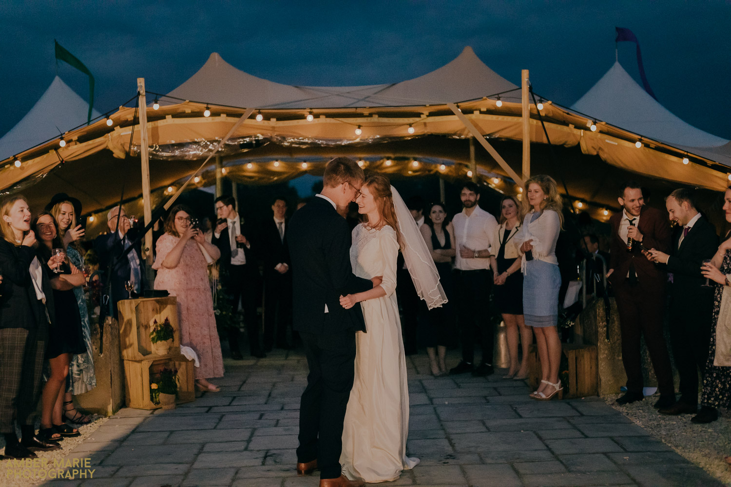 Bride and groom dancing in front of Tipi at Jenners Barn wedding
