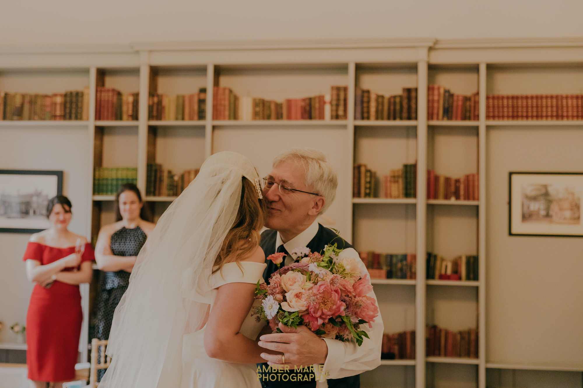 Dad kissing bride on cheek