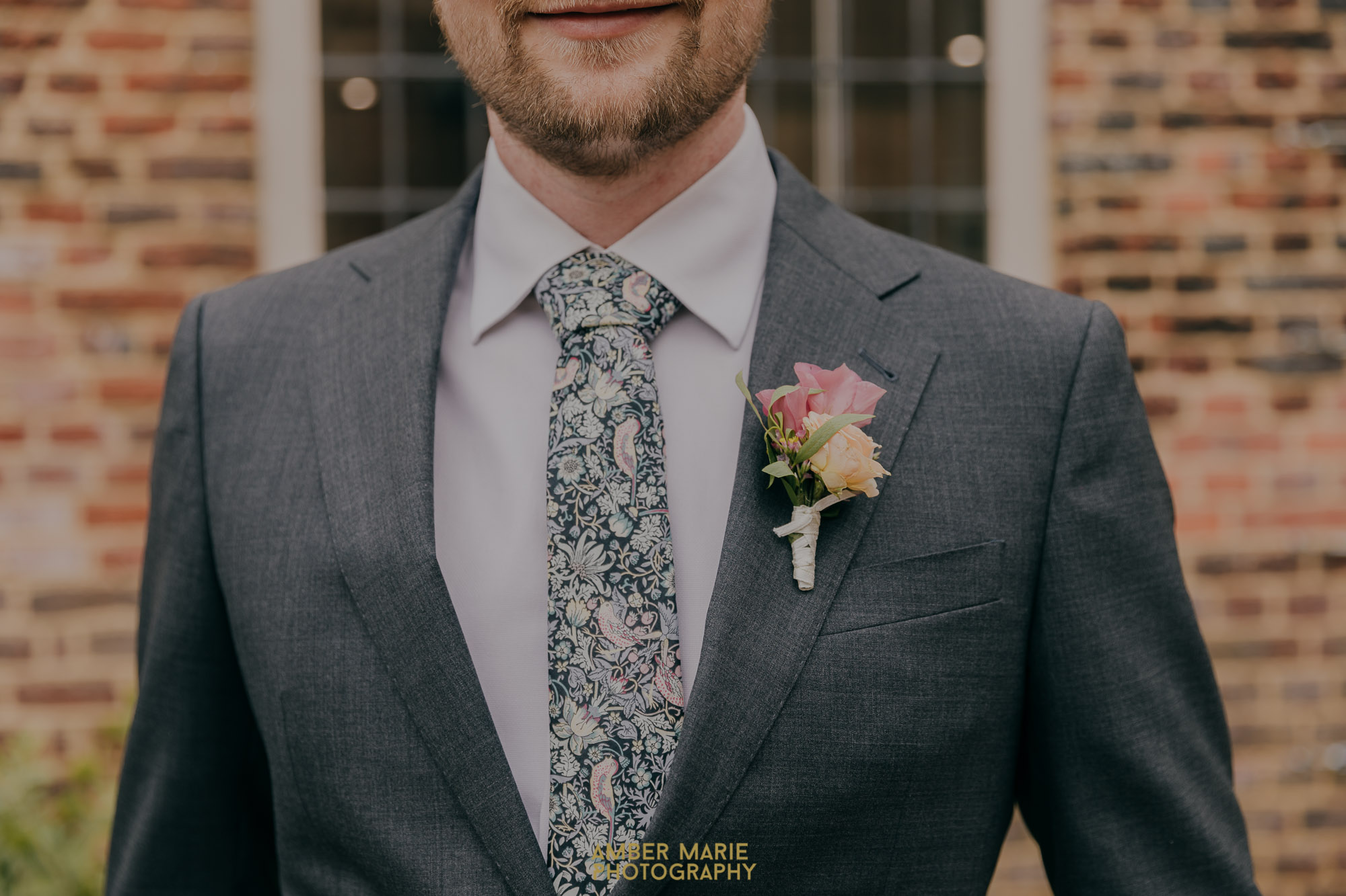 Groom wearing William Morris Tie and pastel buttonhole