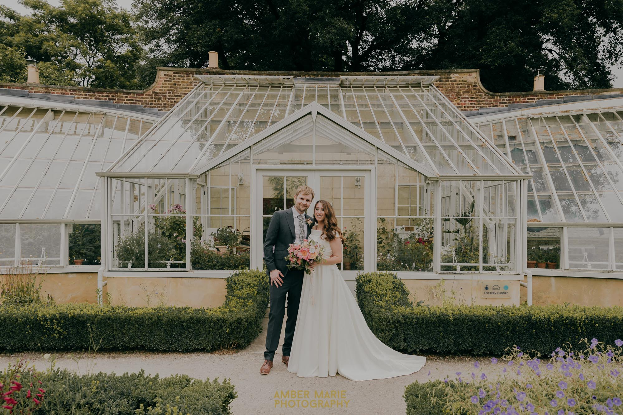 Relaxed portraits of bride and groom in The Walled Garden at Fulham Palace