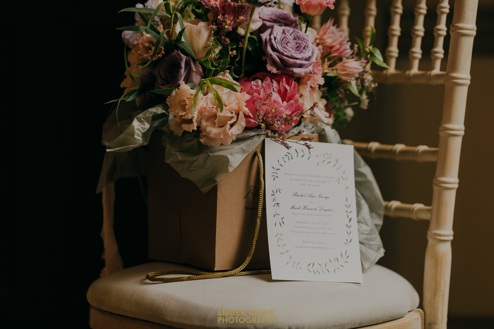 Creative photo of wedding invite and bride's bouquet