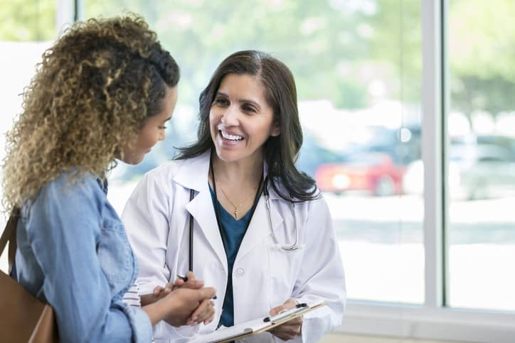 Female Doctor and Patient