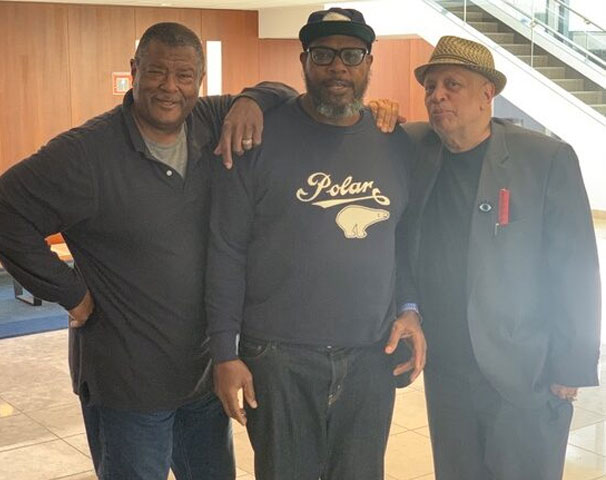 Author Andre Hardy with friends