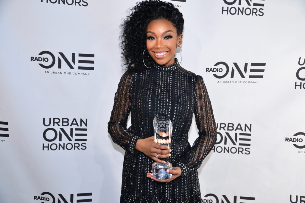 Brandy receives the Cathy Hughes Excellence Award at inaugural Urban One Honors (Photo Credit: TV One)