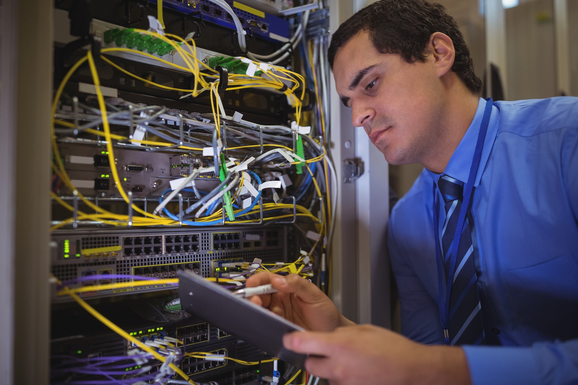 Technician maintaining record of rack