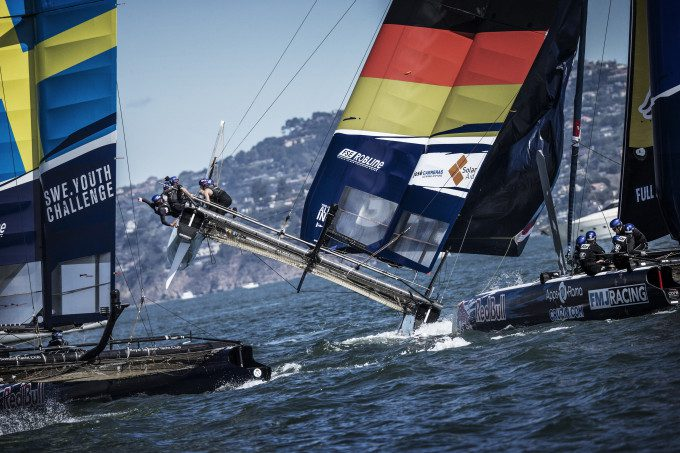 Members of Swedish Youth Challenge and All In Racing of Germany compete during the third race of the Red Bull Youth America's Cup in San Francisco, California on September 2, 2013.