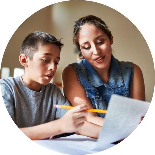 Therapist instructing child on handwriting at school