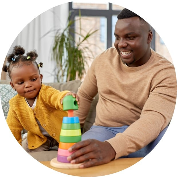 Dad playing with child to work on visual motor skills