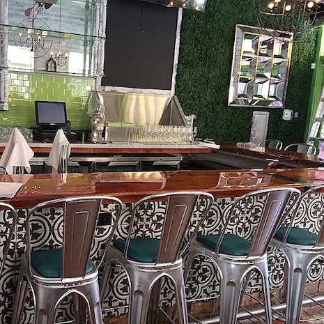 Handmade tiles decorate the bar designed by owner Julien Grimaud. /courtesy photo