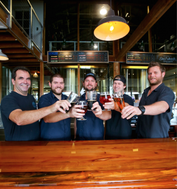 Saltwater Brewery's founders toast to the new venture in 2013.