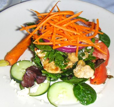 The Super Veggie Salad ($14) features garbanzo beans, black beans, corn, feta cheese, carrots, cucumbers, tomatoes, and red onions. Other ingredients, such as chicken, are available with it.