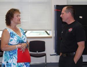 Everett Medic Travis Gamm talks with Gloria Savinski