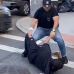 NYPD Cop placed on desk duty for punching bystander for not social distancing.