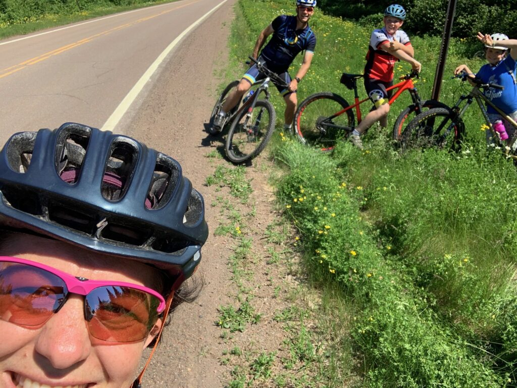 stopped at the side of the road riding bikes
