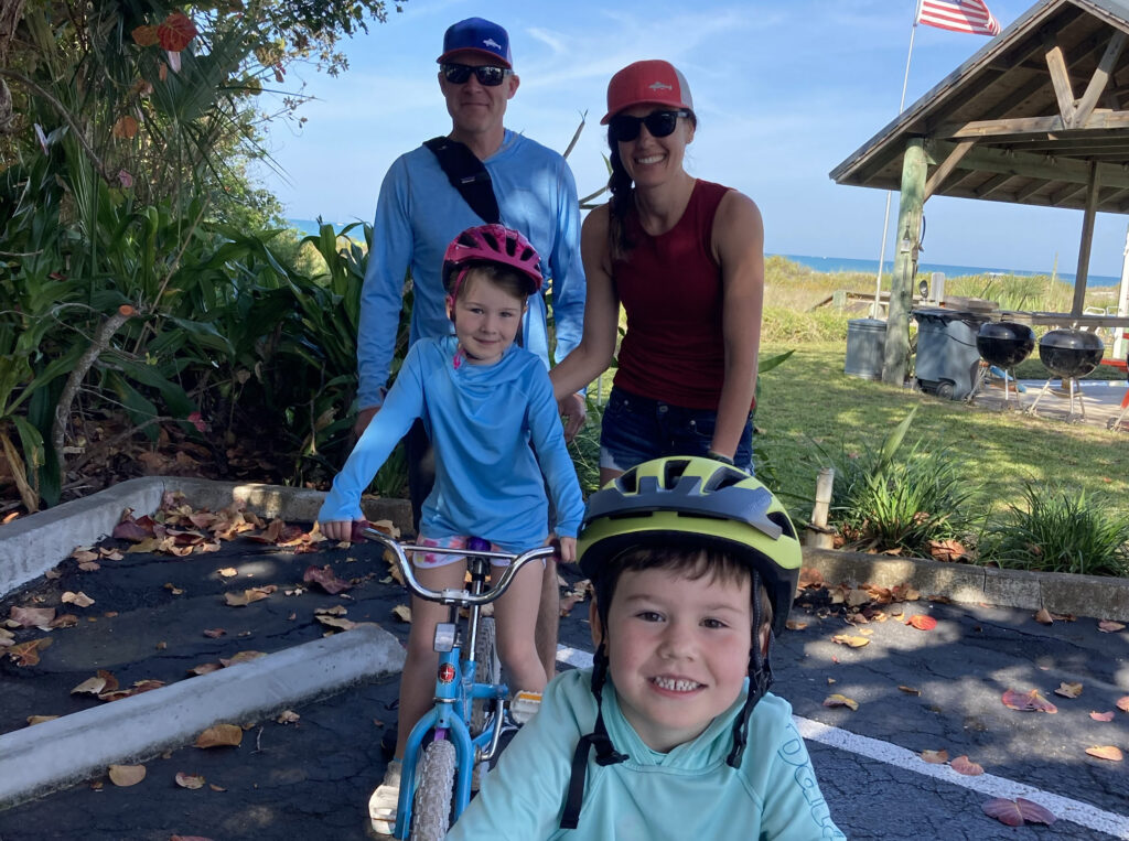 mom with family riding bike