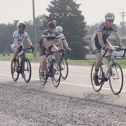 Riders head north to quieter roads at the start of the road ride.